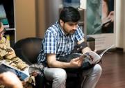 Student Reading Iliad Guide Book